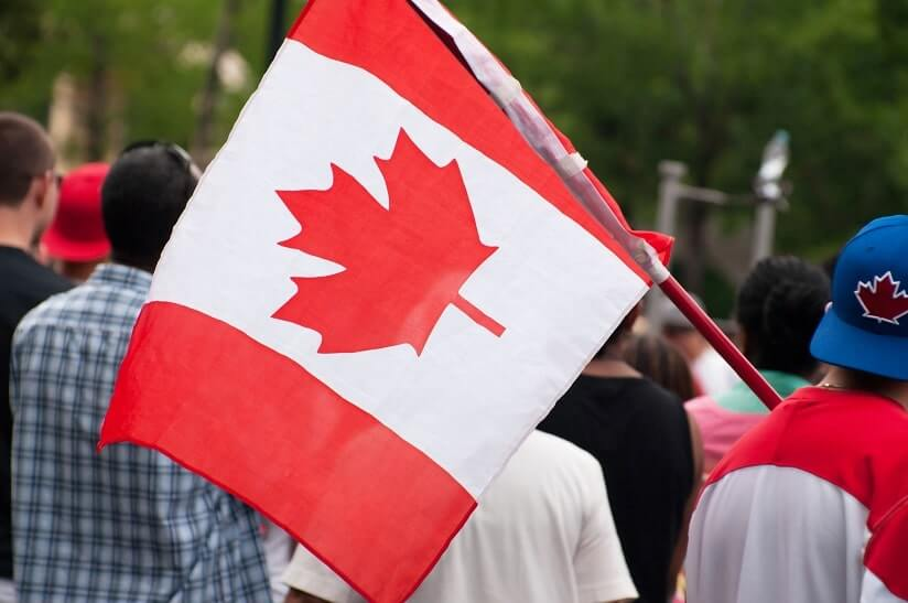 a person holding the Canadian flag