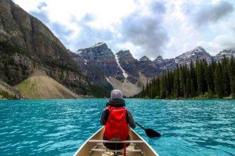 man in a boat in Banff, Canada