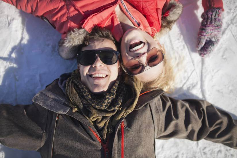 happy couple in a winter resort