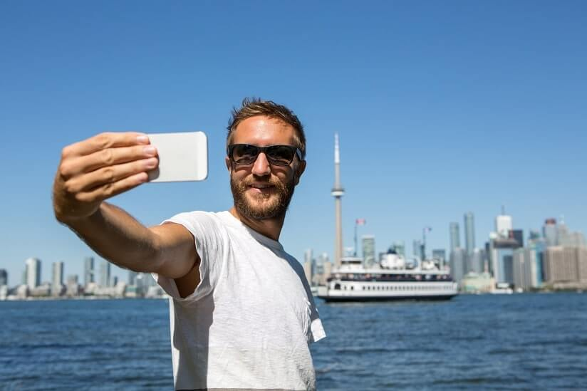 a man taking a photo in Canada