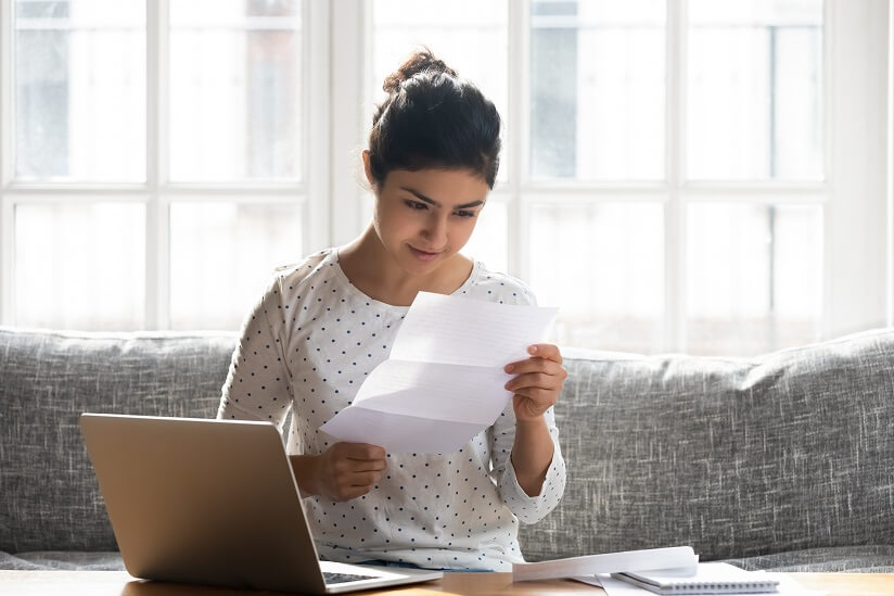 student looking at a tax document
