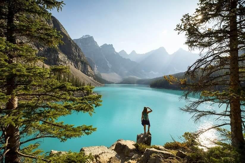 a woman looking at a Canadian lake